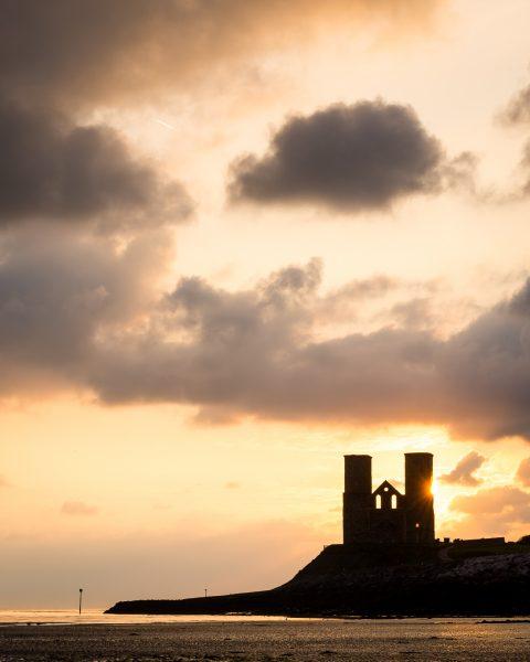 sunrise behind reculver towers, kent coast