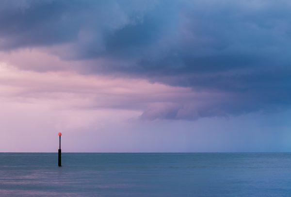 storm clouds passing at twilight on kent coast