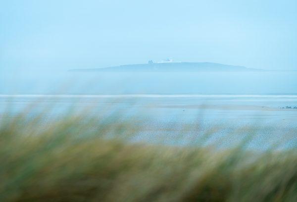 farne island lighthouse form Seahouses dunes beach