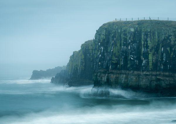 stormy weather on dunstanburgh Gull Crag cliffs