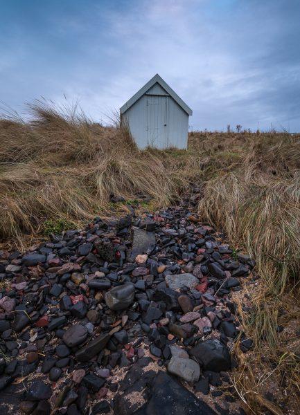 bamburgh castle hut beach northumberland