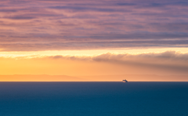 ferry crossing the english channel at sunrise