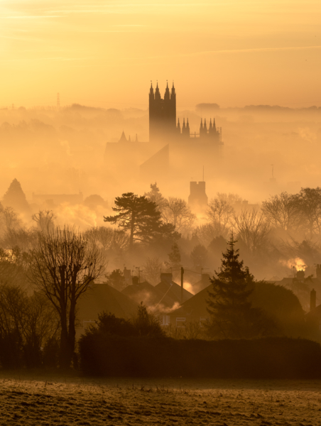 Canterbury Cathedral silhouetted in the mist at sunrise