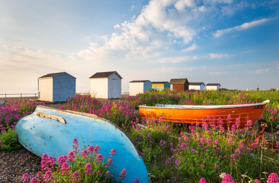 beach huts and fishing boats on kingsdown beach, kent